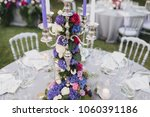 flower arrangement stands on... | Shutterstock . vector #1060391186