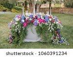 flower arrangement stands on... | Shutterstock . vector #1060391234