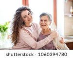 a teenage girl with grandmother ... | Shutterstock . vector #1060394780