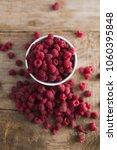 bowl of fresh raspberries   Shutterstock . vector #1060395848