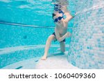 young boy playing underwater in ... | Shutterstock . vector #1060409360
