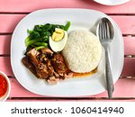 stewed pork leg on rice with... | Shutterstock . vector #1060414940