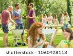redhead girl talks to her... | Shutterstock . vector #1060428113