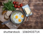 fried eggs in a frying pan with ... | Shutterstock . vector #1060433714