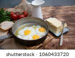 fried eggs in a frying pan with ... | Shutterstock . vector #1060433720