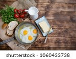 fried eggs in a frying pan with ... | Shutterstock . vector #1060433738