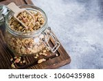 homemade granola with nut mix... | Shutterstock . vector #1060435988