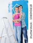 happy young couple paint in... | Shutterstock . vector #106043618