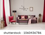 red armchair and wooden lamp...   Shutterstock . vector #1060436786