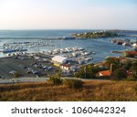 seaside view. bay with boats in ... | Shutterstock . vector #1060442324