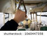 the man's hand holds onto the... | Shutterstock . vector #1060447358