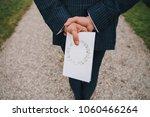 man in suit is standing on path ... | Shutterstock . vector #1060466264