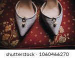 shoes stand on a red vintage... | Shutterstock . vector #1060466270