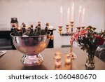 on the table is a vase with... | Shutterstock . vector #1060480670