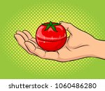 tomato timer at hand pop art... | Shutterstock .eps vector #1060486280