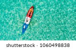 top view on a kayak boat on the ...   Shutterstock . vector #1060498838
