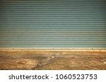 old folding metal door with...   Shutterstock . vector #1060523753