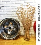 dry grass vase and alloy wheels | Shutterstock . vector #1060531454