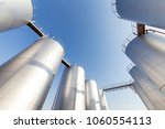 silver oil tank in the blue sky ... | Shutterstock . vector #1060554113