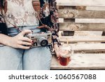 stylish hipster woman holding... | Shutterstock . vector #1060567088