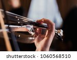 plays the violin by hand ... | Shutterstock . vector #1060568510