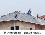 workers installing concrete... | Shutterstock . vector #1060578080