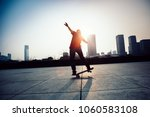skateboarder skateboarding at... | Shutterstock . vector #1060583108