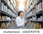 young asian man standing...   Shutterstock . vector #1060592978