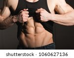 perfect man shows his six pack... | Shutterstock . vector #1060627136