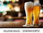 fresh cold beer in bar  | Shutterstock . vector #1060641893