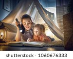 family bedtime. mom and child... | Shutterstock . vector #1060676333