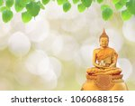 statue buddha and bodhi leaf on ...   Shutterstock . vector #1060688156