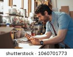 skilled young craftsman... | Shutterstock . vector #1060701773