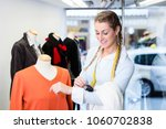 window dresser working at shop... | Shutterstock . vector #1060702838