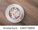 white coffee cup with dessert... | Shutterstock . vector #1060728800