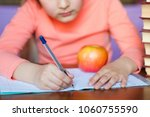 school girl writing something... | Shutterstock . vector #1060755590