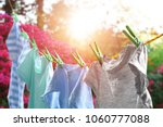 rope with clean clothes... | Shutterstock . vector #1060777088