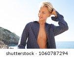 tourist male visiting rocky...   Shutterstock . vector #1060787294