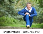 senior man stretching on... | Shutterstock . vector #1060787540