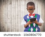 boy in vest and bowtie with... | Shutterstock . vector #1060806770