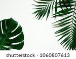 green flat lay tropical palm...   Shutterstock . vector #1060807613