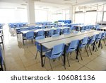 Stock photo clean school cafeteria with many empty seats and tables 106081136