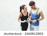 happy man and woman standing ... | Shutterstock . vector #1060812803