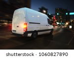 fast van on a city road... | Shutterstock . vector #1060827890
