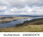 Small photo of View of Lake Windermere, from Gummer's How, on a cloudy day, with beautiful mountains in the distance