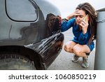 woman stand near scratched auto.... | Shutterstock . vector #1060850219