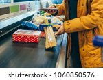 woman put products on cash line ... | Shutterstock . vector #1060850576