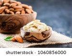 almonds in bowl in background.... | Shutterstock . vector #1060856000