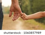 the parent holds the hand of a... | Shutterstock . vector #1060857989