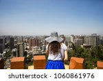 young woman looking at santiago ... | Shutterstock . vector #1060861976